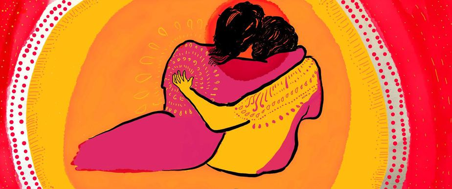 Two figures with their back to us are embracing each other lovingly. They are surrounded by circles of bright colours – shades of yellow and red.