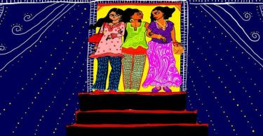 Three women stand against a dark blue background. They are wearing brightly coloured clothes and holding hands. They stand at the top of a staircase.