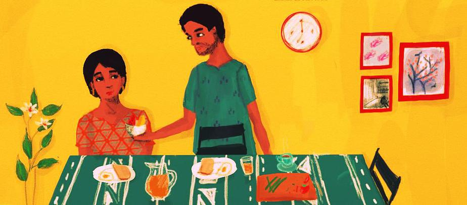 A figure seated at a dining table laden with breakfast looks up uncertainly at another person, who is offering her a bowl of food. The room they are in has a bright yellow wall, decorated with a clock and pictures. A house plant blooms in a corner.