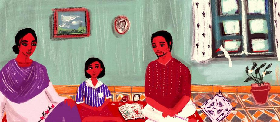 Description: A young child sits between two adults, one wearing a salwar kameez and the other a red kurta. They look down at the child, smiling. The three sit on the floor of a home, with an open book beside them. There is a potted plant in the background, two paintings on the wall, and a window on the right, with a bird perched against the sill.