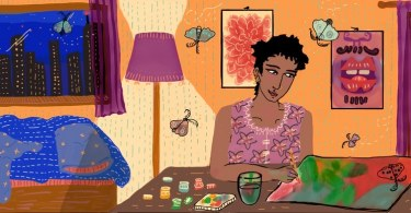 A person with black cropped hair sits at a table painting. On the canvas is a painted moth. In the background, more moths flutter around them and we see a bed, a lamp, paintings on the wall and the night sky through a large window.