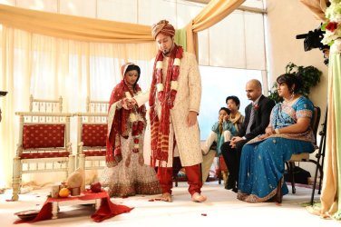 This couple had a Hindu wedding ceremony - a flame is no worries at the Radisson Newport Beach.