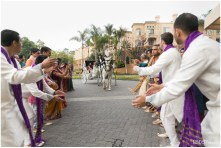 Groom arriving for his baraat on a horse and carriage