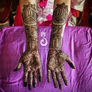 An Indian bride's mehndi up to her elbows