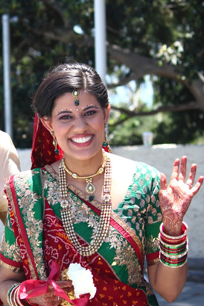 Indian bride in full makeup smiling