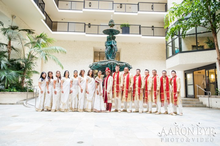 Reha-Vijay-Newport-Beach-Marriott-South-Asian-wedding-Indian_wedding-Hindu-Jain-North_Indian-head-table-ballroom-Aaron-Eye-Photography-bridal-party-Atrium-fountain