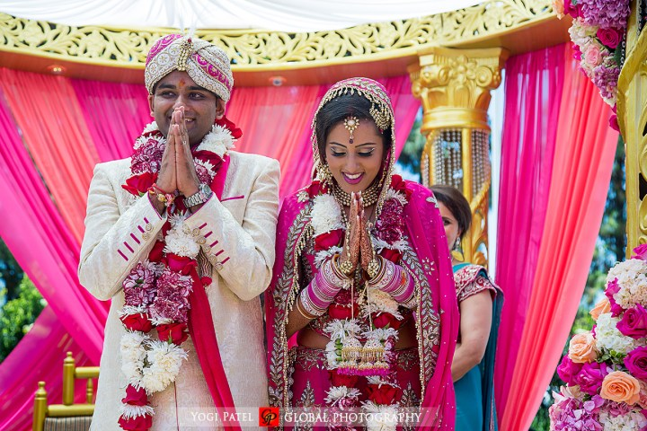 Indian wedding bride and groom with their varmala after their Jain Punjabi wedding ceremony