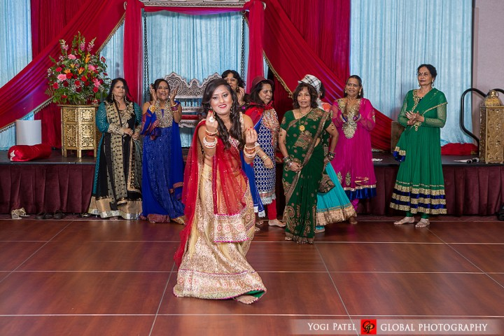 The groom's sister doing a Bollywood dance at the Indian wedding sangeet.