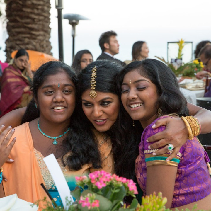 The bride mingling with guests at her wedding reception