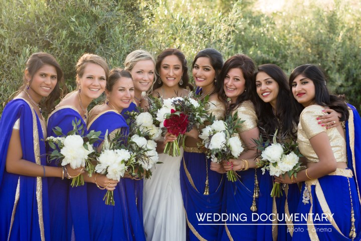 An Indian bride ready for her Christian wedding ceremony with her bridesmaids.