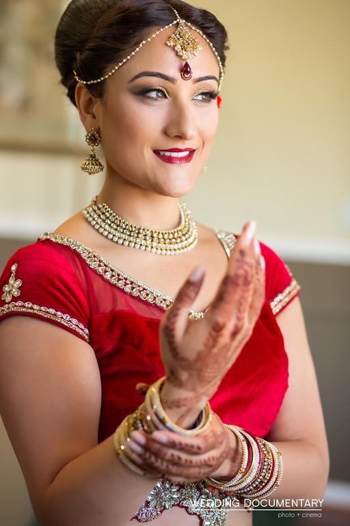 Indian bride showing her mehndi before her Indian Hindu wedding