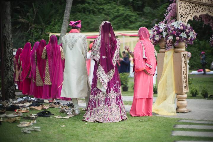 Bridesmaids and the bride about to enter the Anand Karaj on the beach in Phuket, Thailand.