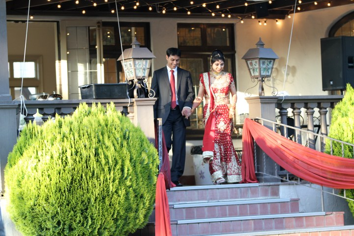 Smita-Aravind-Indian-wedding-mandap-Hindu-outdoor-wedding-ceremony-bride-walking-down-aisle-lehenga-dupatta-mehndi-tikka-nosering-nath-Tamil-Oriya-grand-entrance