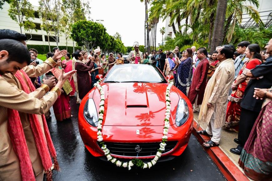 Red Ferrari baraat at an Indian wedding