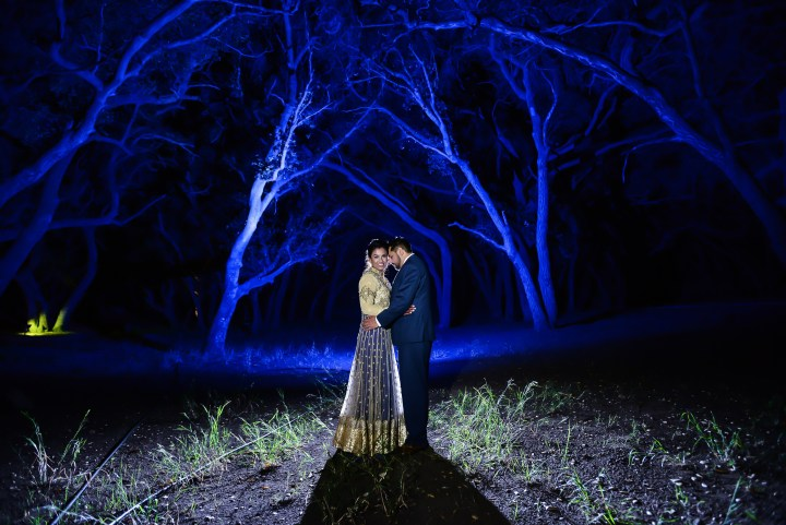 Rakhee-Amrish-gift-exchange-Indian-wedding-venue-photography-Greycard-Hindu-outdoor-dresses-bride-groom-vineyard-South-Asian-wedding-blue-trees-lighting