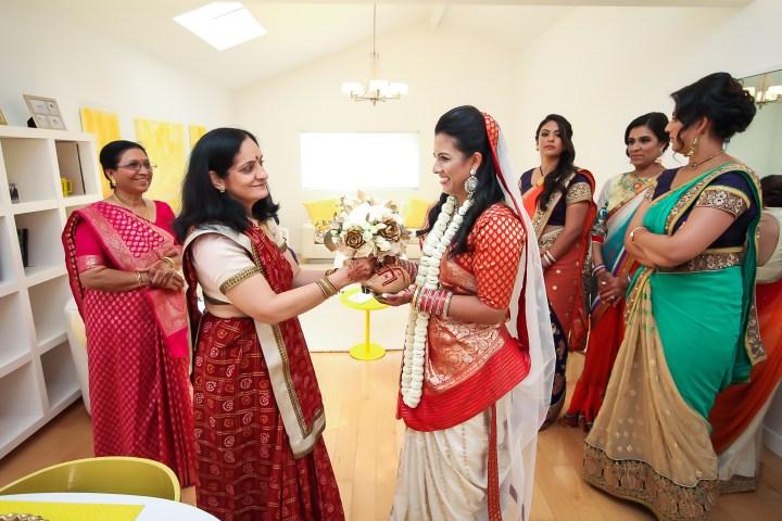Rakhee-Amrish-gift-exchange-Indian-wedding-venue-photography-Greycard-Hindu-outdoor-dresses-bride-groom-vineyard-South-Asian-wedding-bride-with-family