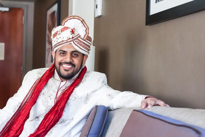 Rakhee-Amrish-gift-exchange-Indian-wedding-venue-photography-Greycard-Hindu-outdoor-dresses-bride-groom-vineyard-South-Asian-wedding-goom-smiling
