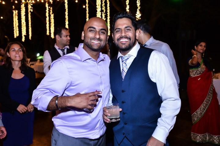 Rakhee-Amrish-gift-exchange-Indian-wedding-venue-photography-Greycard-Hindu-outdoor-dresses-bride-groom-vineyard-South-Asian-wedding-groom-brother-in-law