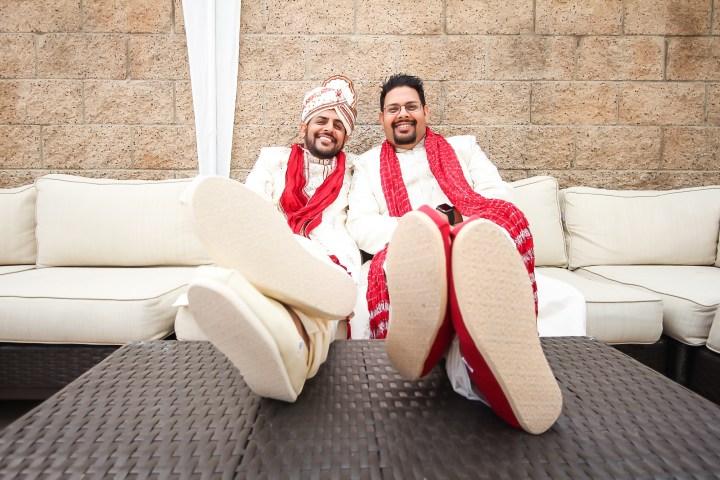 Rakhee-Amrish-gift-exchange-Indian-wedding-venue-photography-Greycard-Hindu-outdoor-dresses-bride-groom-vineyard-South-Asian-wedding-groom-smiling-brother