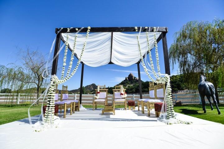 Rakhee-Amrish-gift-exchange-Indian-wedding-venue-photography-Greycard-Hindu-outdoor-dresses-bride-groom-vineyard-South-Asian-wedding-mandap
