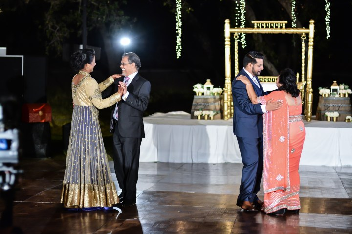 Rakhee dancing with her FIL and Amrish with his mother.