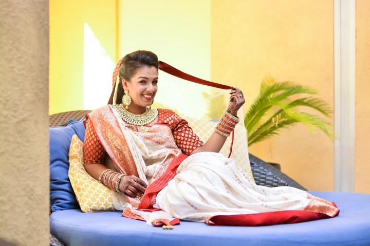 Rakhee-Amrish-gift-exchange-Indian-wedding-venue-photography-Greycard-Hindu-outdoor-dresses-dupatta-ghunghat