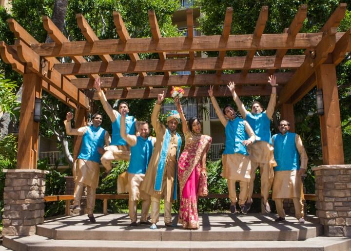 Ashmi-Suraj-Indian-wedding-venue-Hindu-Jain-ceremony-bride-groomsmen-jump-hands-air