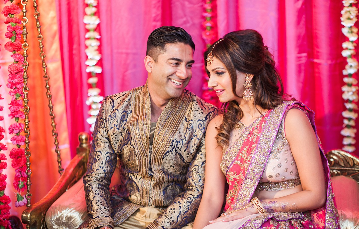 Indian bride and groom chatting at their sangeet
