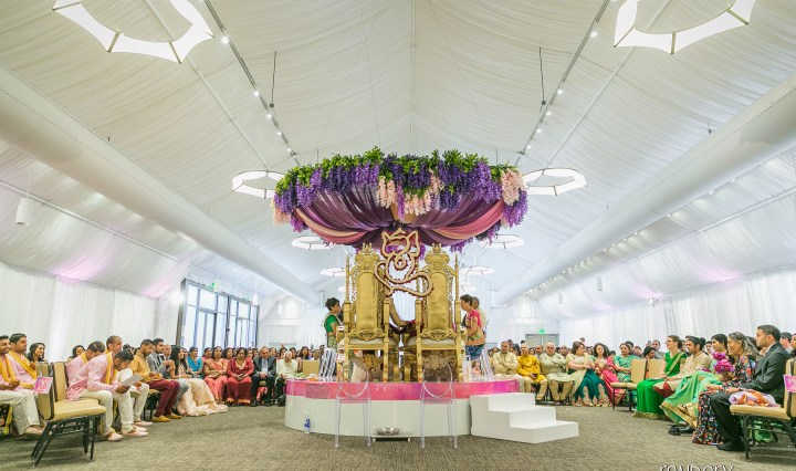 Indian wedding ceremony with an open mandap