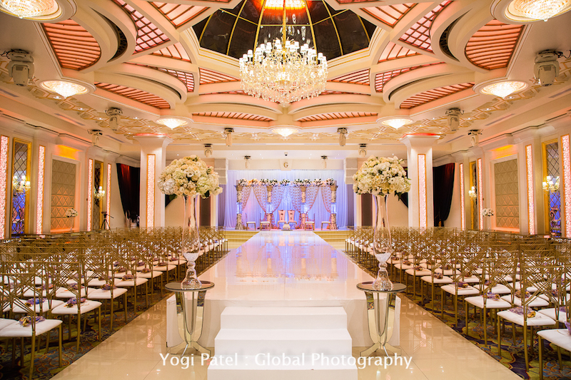 Chairs setup theater style at a banquet hall for an Indian wedding ceremony