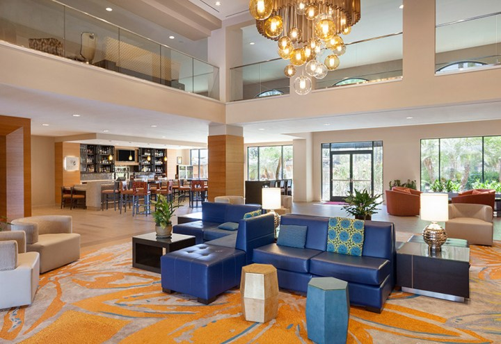 Indian wedding venue, the Delta Marriott in Anaheim, California lobby with colorful, comfortable furniture and lobby bar with high chairs.