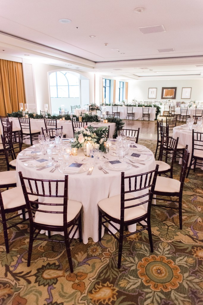 Mahogany chiavari chairs setup at round tables for a banquet at a hotel.