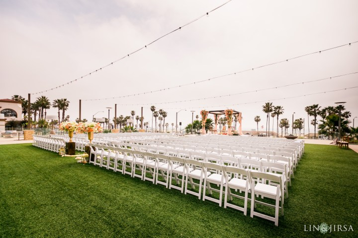 White folding chairs on Ocean Lawn for an Indian wedding
