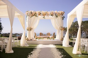 White floral mandap with ocean view