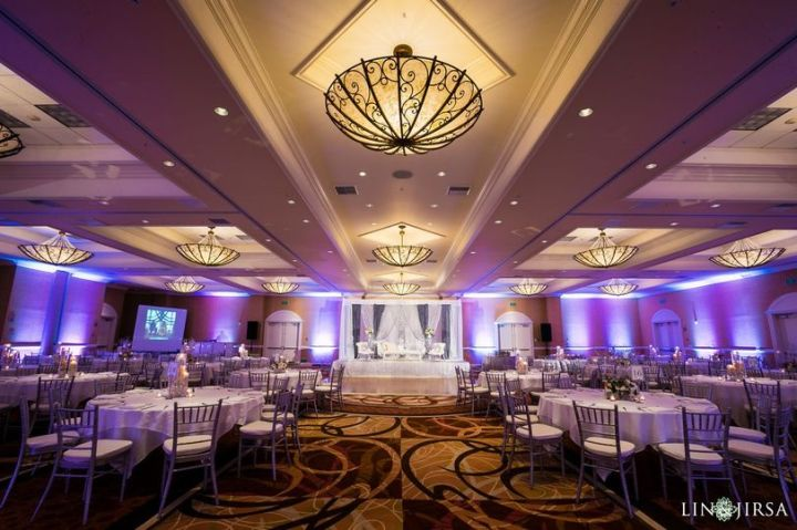 Wedding reception in the Tuscany Ballroom with rented chiavari chairs.
