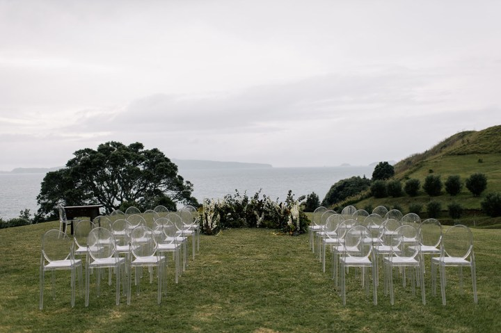Ghost chairs setup for an outdoor Indian wedding
