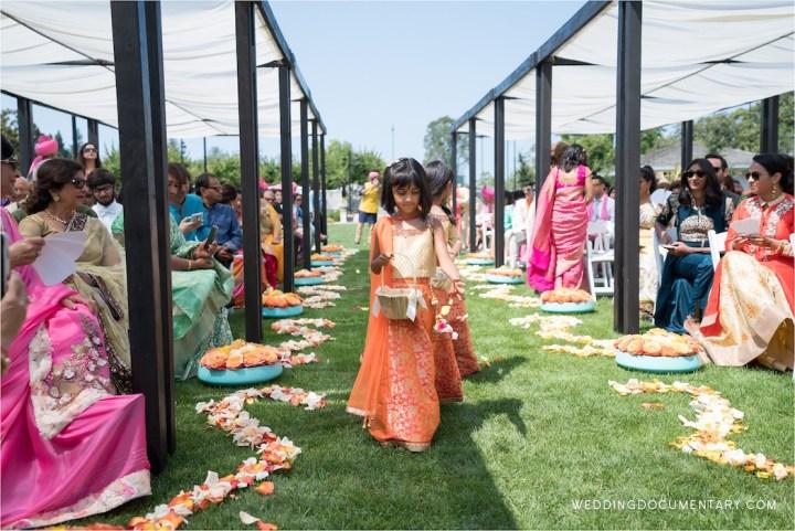Flower girl walking down the aisle at an Indian wedding at Silverado Resort & Spa
