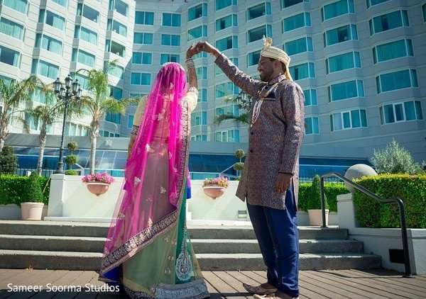 Indian bride and groom's first look photos at he Pullman San Francisco Bay