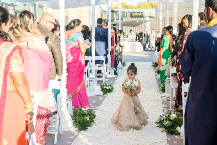 Cute flower girl at an Indian wedding