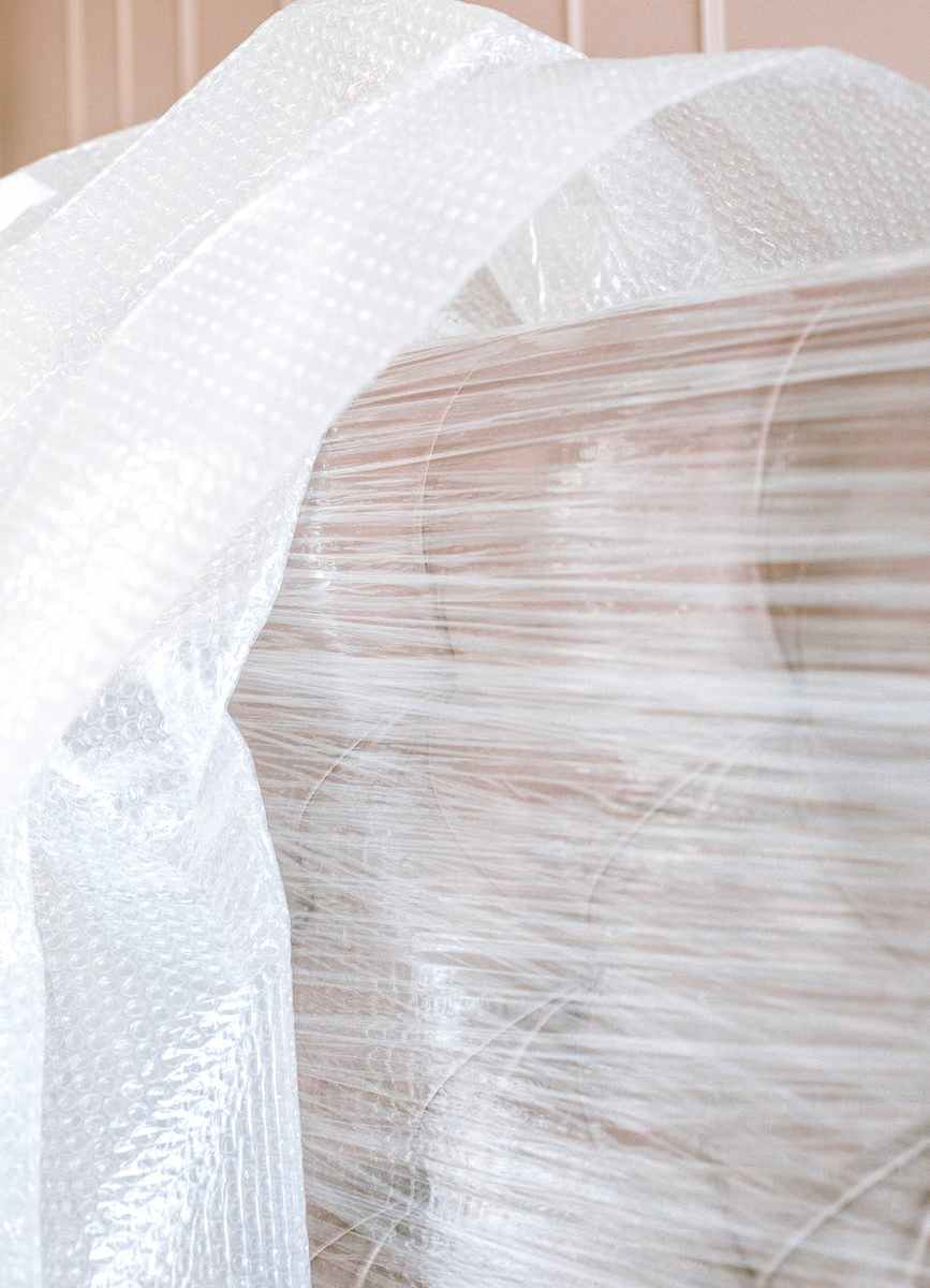 sofa wrapped in plastic