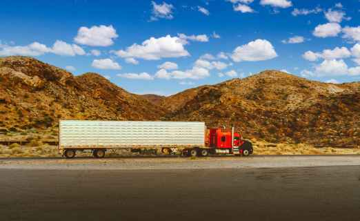 red and white freight truck on road