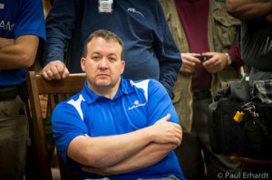 Chad Barber sits through the shooters meeting during the second day of the competition when staff and sponsors got their turn to put rounds down range. Photo by P. Erhardt