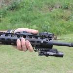 Surefire weapon mounted light at 6 o'clock on the gun.
