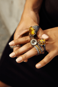 Hand displaying artisan crafted rings.