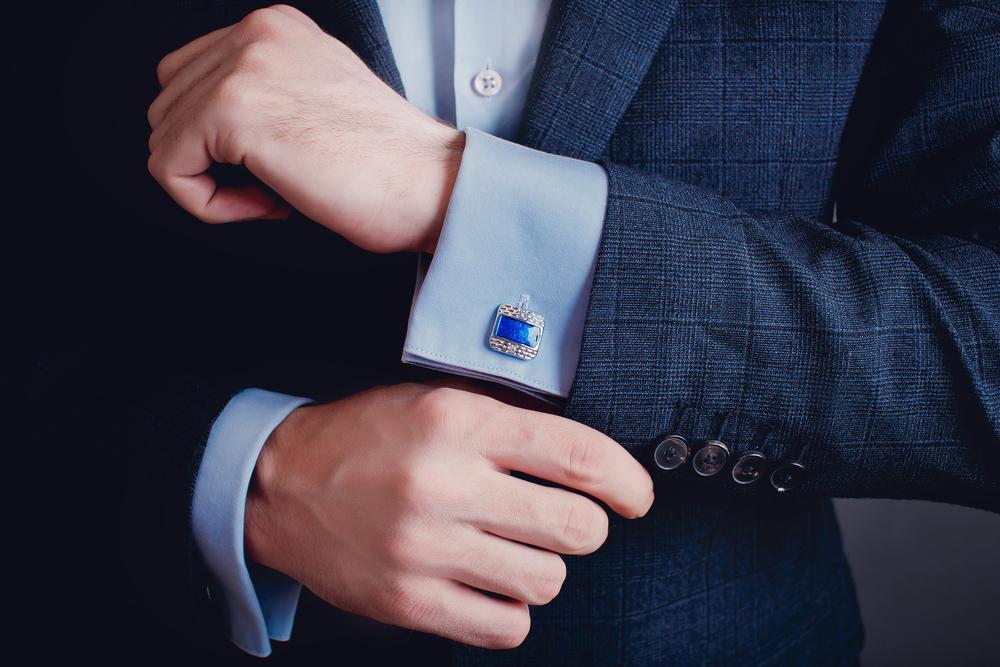 Man tugging onto his cufflinks