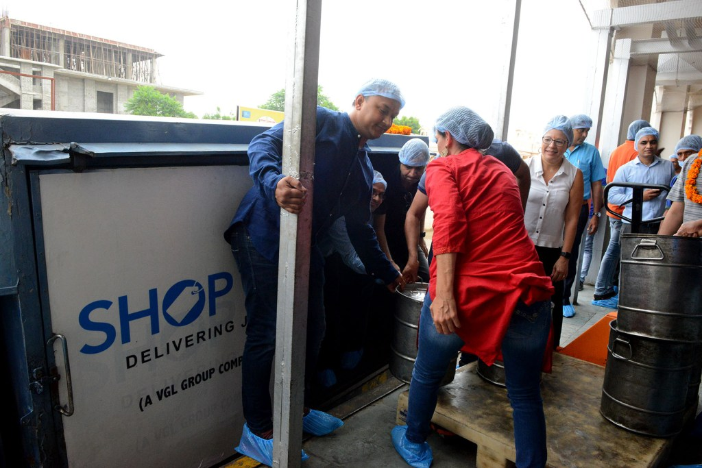 Shop LC employees helping load a truck with healthy meals!