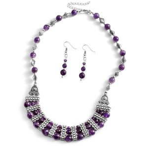 Amethyst jewelry set on white background.