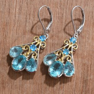 Pairaba apatite dangle earrings in sterling silver with gold accents.