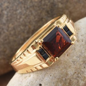 Red garnet men's ring with gold finish.