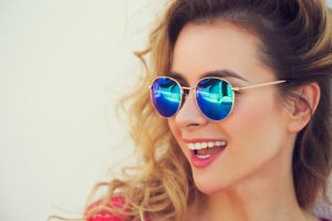 A cool pair of sunglasses protect your eyes in the sun.